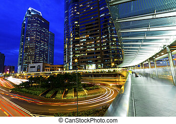 The light trails on the modern building background in Hong Kong
