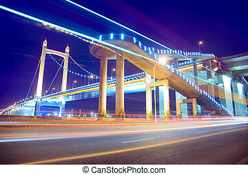 the light trails on the modern suspension bridge background ...