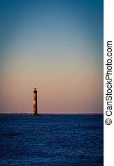 The lighthouse at folly beach in the Atlantic Ocean