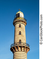 The lighthouse on the beach in Warnemuende, Germany