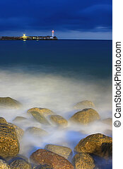 The lighthouse on the shore of the sea storm