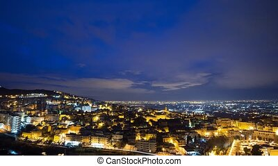 The lights of the city at dawn. Tivoli, Italy. Time Lapse