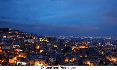 The lights of the city at SunRise. Tivoli, Italy. Time Lapse