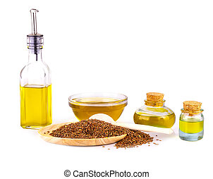 The Linseed oil, bowl of linseeds and wooden spoon on white background