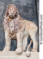 The Lion, ancient marble bas-relief, detail on building wall in Venice, Italy