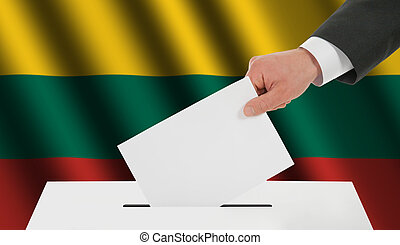 The Lithuanian flag and the hand with the bulletin about the ballot box