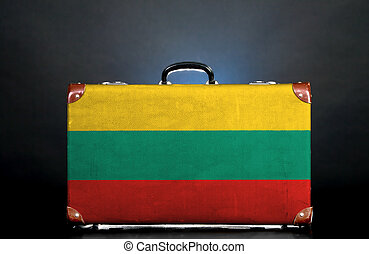 The Lithuanian flag on a suitcase for travel.