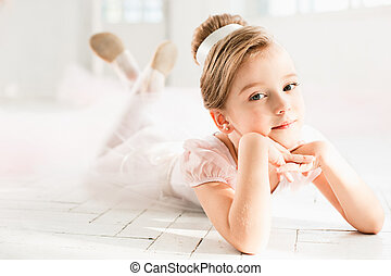 The little balerina in white tutu in class at the ballet...
