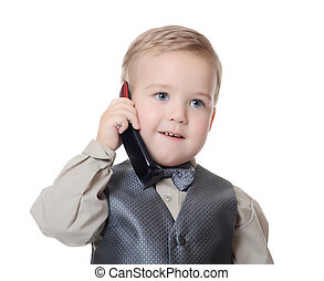 The little boy in a business suit speaks by phone