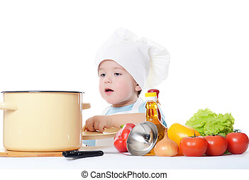 The little boy in a hat of the cook