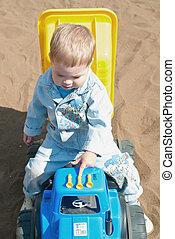 little boy in game car