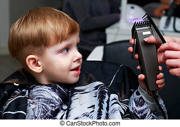 The little boy in the barber shop