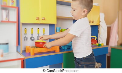 the little boy is playing what is cooking - little boy plays...