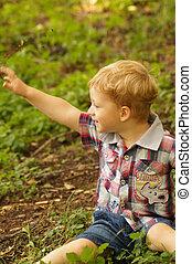 The little boy on walk