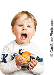 The little boy with an apple and sweets