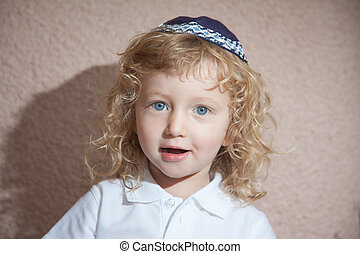The little boy with blond curls in Jewish skullcap - The...