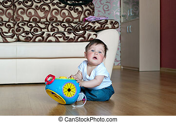 little boy with toy