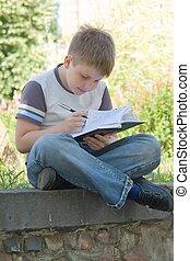 little boy writes
