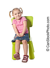 little child sits on a chair - the little child sits on a ...