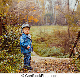 The little cowboy in the autumn park