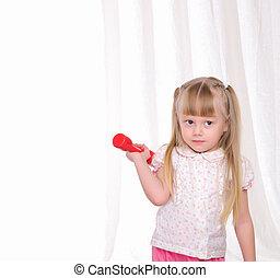 little girl does exercises