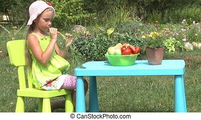 The little girl eats carrot