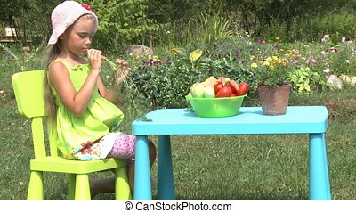The little girl eats carrot - The little girl eats carrot...