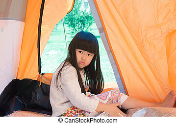 The little girl in a tent