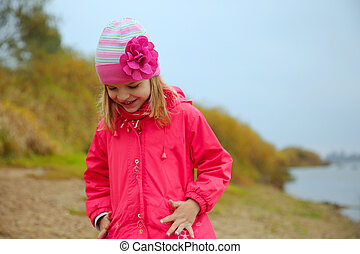 The little girl in rose jacket on