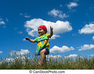 The little girl on a background of the blue sky