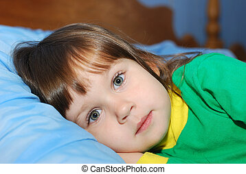The little girl on a bed
