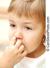 little girl  - The little girl picks her nose