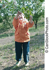 girl plays with branch
