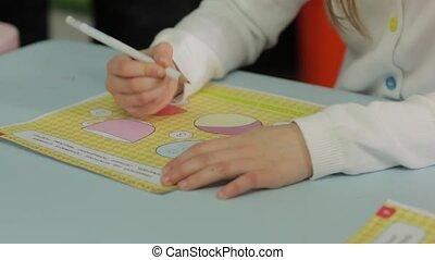 The Little Girl Studying In Kindergarten - The little girl...