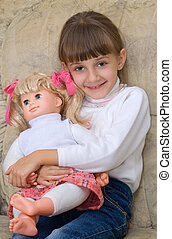 The little girl with a doll