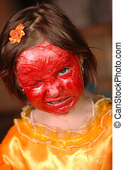 The little girl with a make-up on the face