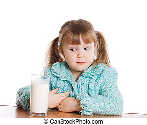 The little girl with a milk glass