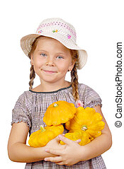 The little girl with bush pumpkins. Isolated over white