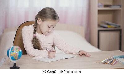 the little girl writes