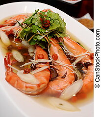 The locally sourced tiger prawn with American distinctive ginseng-taste on white plate
