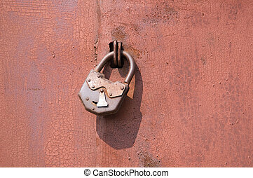The lock on gate - Old padlock on garage collars