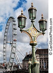 The London Eye - giant Ferris wheel on the South Bank of the River Thames in London