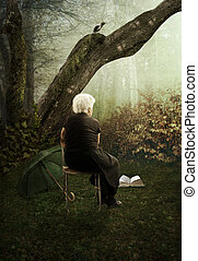 The loneliness - Lonely, old woman in autumn park
