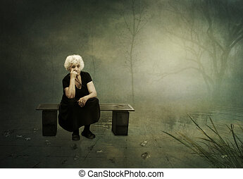 The loneliness of autumn - An elderly woman with white hair,...