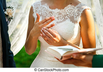 The lovely brides wears rings
