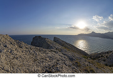 The low late afternoon sun over the coastal mountains. Crimea, September.