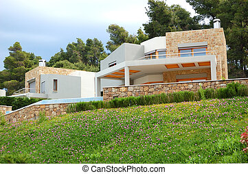 The luxury villa and green lawn, Halkidiki, Greece
