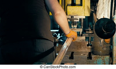 The machine cuts the sheet metal. Large hydraulic guillotine...