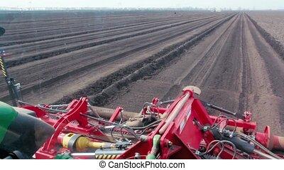 The machine plows ground