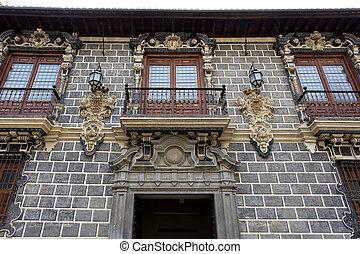 The facade of Palacio de la Madraza, Madrasah of Granada, in...
